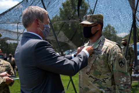Gov. Bill Lee presents the Soldier's Medal to Sgt. 1st Class Patrick Shields, a member of the Tennessee National Guard's Detachment 1, 1175th Transportation Company, in Brownsville on July 10. Shields stopped, disarmed and restrained a gunman after shots were fired in a parking lot following a high school football game in October 2018. (Staff Sgt. Timothy Cordeiro)
