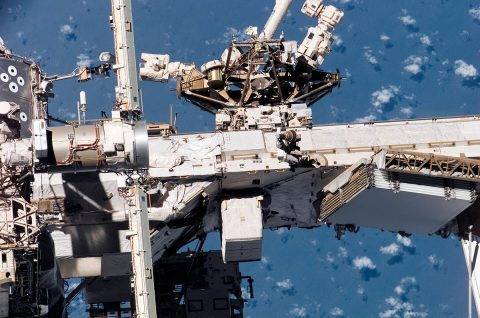 The Mobile Base System moves on the Mobile Transporter rail car along truss rails covering the length of the space station. It provides a movable platform for Canadarm2 and Dextre and can access any of eight worksites that feature power connections. (NASA)