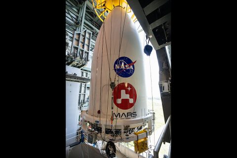 The nose cone containing NASA's Mars 2020 Perseverance rover is maneuvered into place atop its Atlas V rocket. The image was taken at Cape Canaveral Air Force Station in Florida on July 7, 2020. (NASA/KSC)