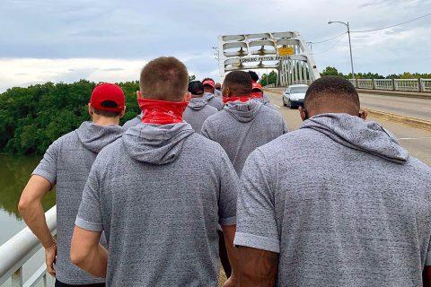 Austin Peay State University football players approach the bridge. (APSU)