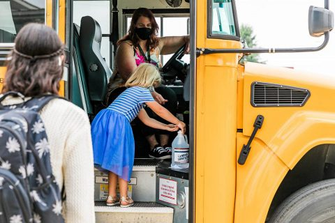 Kids getting on a Clarksville-Montgomery County School System School Bus