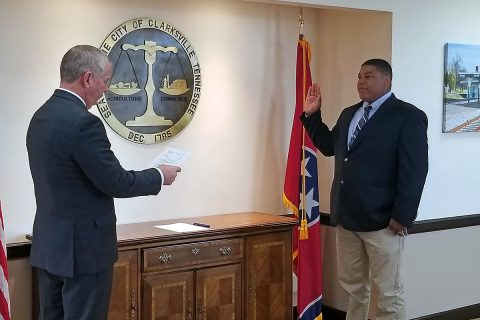 Clarksville Mayor Joe Pitts swears in Donta Daniel, Monday.