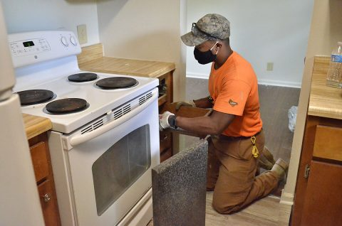 Brandon Barfield, Campbell Crossing-Lendlease maintenance worker, prepares to install kitchen counters in a home in Pierce Village before new residents move in. U.S. Army Garrison-Fort Campbell in partnership with Campbell Crossing-Lendlease has developed a plan for major home construction and renovation in the next five years as part of the long-term goal to replace legacy housing with quality homes for Soldiers and Families assigned to Fort Campbell. (Emily LaForme, Fort Campbell Courier)