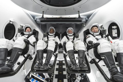 NASA's SpaceX Crew-1 crew members are seen seated in the company's Crew Dragon spacecraft during crew equipment interface training. From left to right are NASA astronauts Shannon Walker, mission specialist; Victor Glover, pilot; and Mike Hopkins, Crew Dragon commander; and JAXA astronaut Soichi Noguchi, mission specialist. (SpaceX)