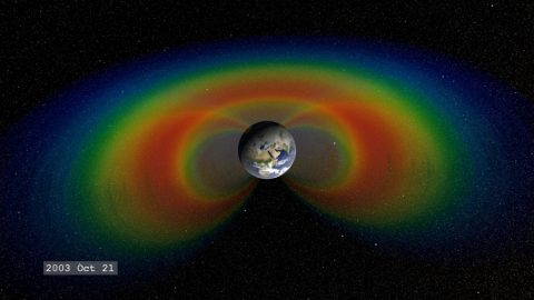 When solar material streams strikes Earth's magnetosphere, it can become trapped and held in two donut-shaped belts around the planet called the Van Allen Belts. The belts restrain the particles to travel along Earth's magnetic field lines, continually bouncing back and forth from pole to pole. (NASA Goddard / Tom Bridgman)