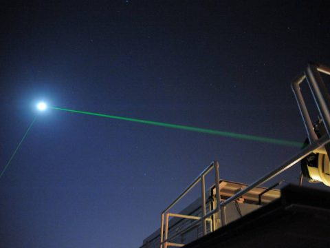 This photograph shows the laser-ranging facility at the Goddard Geophysical and Astronomical Observatory in Greenbelt, Md. The facility helps NASA keep track of orbiting satellites. Both beams shown, coming from two different lasers, are pointed at NASA's Lunar Reconnaissance Orbiter, which is orbiting the Moon. Here, scientists are using the visible, green wavelength of light. (NASA)