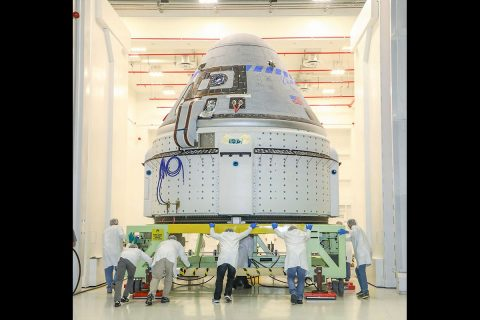 The CST-100 Starliner spacecraft to be flown on Boeing's Orbital Flight Test (OFT) is viewed Nov. 2, 2019, while undergoing launch preparations inside the Commercial Crew and Cargo Processing Facility at Kennedy Space Center in Florida. (Boeing)