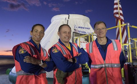 NASA astronauts Nicole Mann, left, Mike Fincke, and Boeing astronaut Chris Ferguson, right, pose for a photograph on Sept. 11, 2019, as they, along with teams from NASA, Boeing and the White Sands Missile Range, rehearse landing and crew extraction from Boeing's CST-100 Starliner. (Boeing)