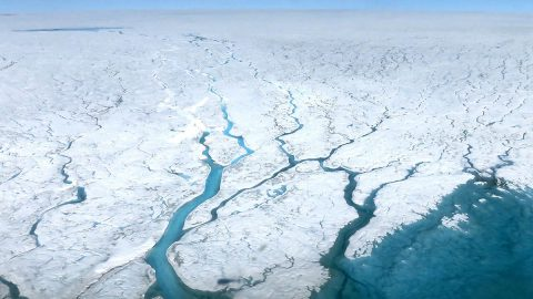 This aerial photograph shows fast-moving meltwater rivers flowing across the Greenland Ice Sheet, a region that, combined with Antarctic meltwater and thermal expansion, accounts for two-thirds of observed global mean sea level rise. (NASA)