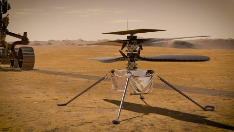 In this artist's concept, NASA's Ingenuity Mars Helicopter stands on the Red Planet's surface as NASA's Mars 2020 Perseverance rover (partially visible on the left) rolls away. (NASA/JPL-Caltech)