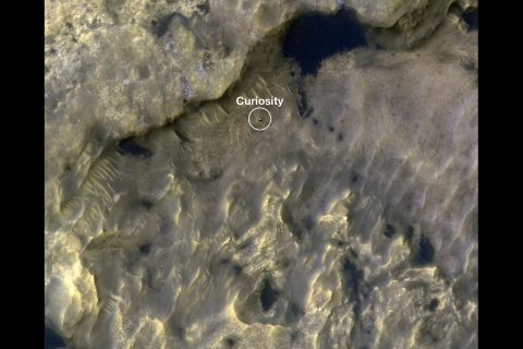"""This image shows the position of NASA's Curiosity rover as it journeyed 1,106 feet (337 meters) through an area of Mount Sharp called """"the clay-bearing unit"""" between May 31 and July 20, 2019. Each of these two images were taken by the HiRISE camera on NASA's Mars Reconnaissance Orbiter. (NASA/JPL-Caltech/University of Arizona)"""