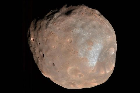 The High Resolution Imaging Science Experiment (HiRISE) camera on NASA's Mars Reconnaissance Orbiter took two images of the larger of Mars' two moons, Phobos, within 10 minutes of each other on March 23rd, 2008. This is the first, taken from a distance of about 6,800 kilometers (about 4,200 miles). It is presented in color by combining data from the camera's blue-green, red, and near-infrared channels. (NASA/JPL-Caltech/University of Arizona)
