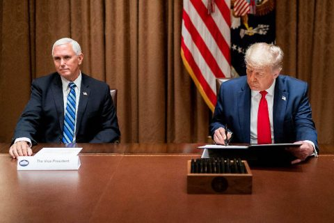 President Donald Trump, joined by Vice President Mike Pence, signs an Executive Order on Hiring American. (White House)