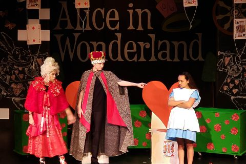 Roxy Regional Theatre School of the Arts students performing in 2019's production of Disney's Alice in Wonderland, Jr.