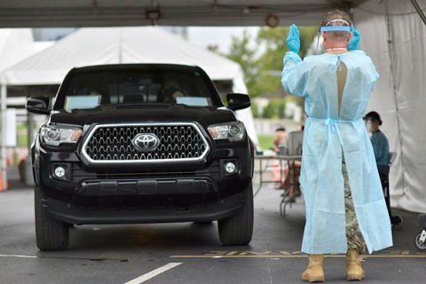 Staff Sgt. Carl Terry guides a vehicle at the Nissan Stadium testing site, in downtown Nashville, Aug. 21.  Since March, over 2,000 Tennessee National Guardsmen have been activated in some capacity to assist their communities in the fight against COVID-19. (Staff Sgt. Timothy Cordeiro)