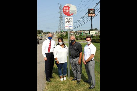 FastSigns of Clarksville, which is moving to 119 West Dunbar Cave Road, Clarksville, on Oct. 1, has joined with Clarksville Transit's Adopt-A-Stop program to take care of several bus stops along Wilma Rudolph Boulevard. FastSigns Owner Alan Grayson helped unveil signs Friday with from left, Mayor Joe Pitts, Veronica Williams, and CTS Director Paul Nelson