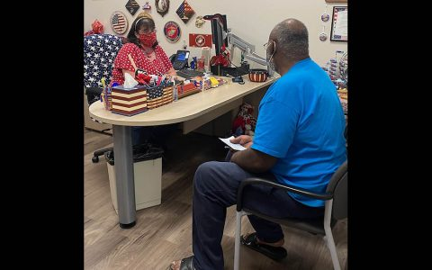 Montgomery County Veterans Service Organization Assistant Director Stacey Hopwood (left) helping a veteran.