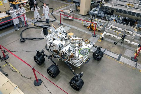 Engineers test drive the Earth-bound twin of NASA's Perseverance Mars rover for the first time in a warehouselike assembly room at the agency's Jet Propulsion Laboratory in Southern California. (NASA/JPL-Caltech)