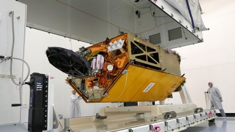The Sentinel-6 Michael Freilich spacecraft undergoes tests at its manufacturer Airbus in Friedrichshafen, Germany, in 2019. The white GNSS-RO instrument can be seen attached to the upper left portion of the front of the spacecraft. (Airbus)