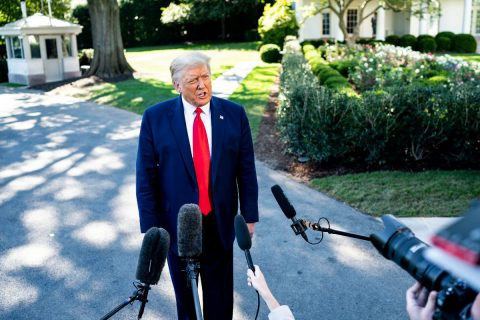 President Donald Trump talks to members of the press along the South Lawn driveway. (White House)