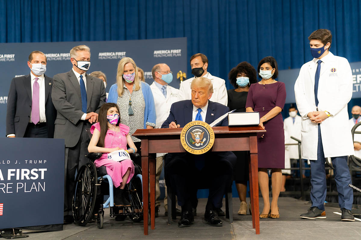 President Donald Trump signs an executive order on the America First Healthcare Plan in Charlotte, North Carolina. (White House)