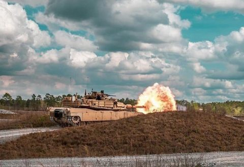 Tank crews assigned to the 278th Armored Cavalry Regiment fires the main cannon of an M1 Abrams tank during tank gunnery at Camp Shelby, Mississippi. (Sgt. Art Guzman)