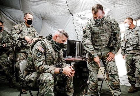 Maj. Gen. Jeff Holmes, Tennessee's Adjutant General, receives an operations briefing from Maj. Brian Tomberlin, the 278th Armored Cavalry Regiment's Operations Officer, at the 278th's Command Post during Annual Training at Tullahoma's Volunteer Training Site on Aug. 16. (Sgt. Art Guzman)