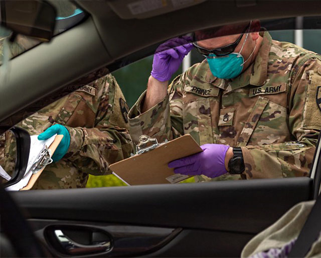 Tenenssee National Guard Soldiers assigned to Task Force Medical conduct COVID-19 testing at the drive-thru testing site in Coffee County on April 19th.