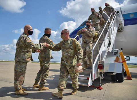 Soldiers from the 194th Engineer Brigade are greeted by Maj. Gen. Jeff Holmes, Tennessee's Adjutant General, and Maj. Gen. Tommy Baker, Deputy Adjutant General, in Nashville, Sept. 17, following a year-long deployment to the middle-east. The Guardsmen have been quarantining and undergoing a demobilization process for two weeks in Texas before being reunited with loved ones in Tennessee. (U.S. Army Staff Sgt. Timothy Cordeiro)