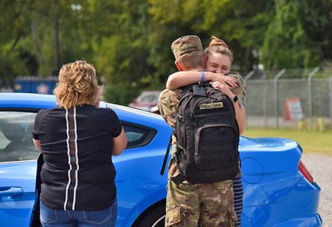 Soldiers from the 194th Engineer Brigade are greeted by loved ones at an improvised, drive-thru homecoming ceremony, in Smyrna, Sept. 17, following a year-long deployment to the middle-east. Extra distancing measures were put in place to ensure everyone's safety, as the Guardsmen have been quarantining and undergoing a demobilization process for two weeks in Texas before returning to Tennessee. (U.S. Army Staff Sgt. Timothy Cordeiro)