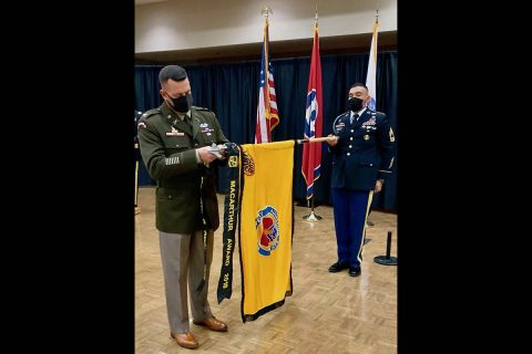 Clemmer places the MacArthur Award streamer on the Austin Peay State University Army ROTC colors, held by Master Sergeant Marcus Gurule, APSU senior military instructor. (APSU)