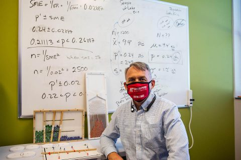 Austin Peay State University's Sam Ligo sits with some of the models he has created for his students. (APSU)
