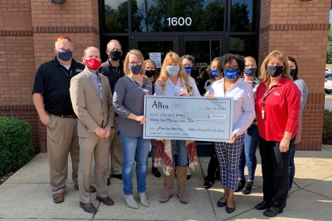 Altra employees: Rose Melton, Jesse Presley, Gail Fielder, Dan Schwaab, Brian Selph, Heather Cheesman. Valerie Guzman, Stephanie Knight, and Brandi Ficklin from United Way of Greater Clarksville with Leslie Chiodini from Community Action Agency and Terri Williams from Crisis 211.