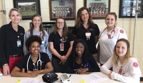 Austin Peay State University School of Nursing interim director Dr. Eve Rice (Left) with APSU nursing students and faculty. (APSU)