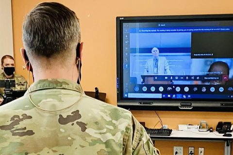 Blanchfield Army Community Hospital Commander Col. Patrick T. Birchfield listens as Army Medicine Chief of Staff and Chief of the Army Medical Department Civilian Corps Mr. Richard Beauchemin praises a team of BACH Soldiers and Department of the Army Civilians for their innovative process-improvement initiative to streamline patient access to behavioral health resources within the hospital's primary care clinics.