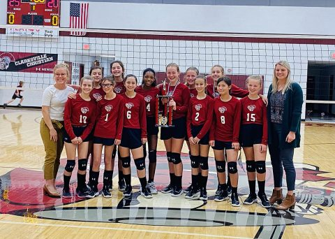 The Clarksville Christian School middle school team celebrates along with assistant Coach, Lexi Hendrix (far left), and head Coach Madison Poen (right).