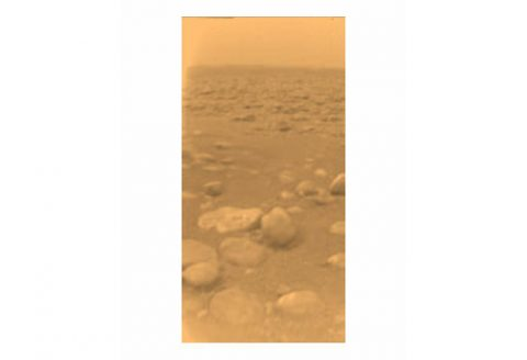 This image was returned January 14, 2005 by the European Space Agency's Huygens probe during its successful descent to Titan's surface. This is the colored view that's been processed to add reflection spectra data to give better indication of the actual color of Titan's surface. (NASA/JPL/ESA/University of Arizona)