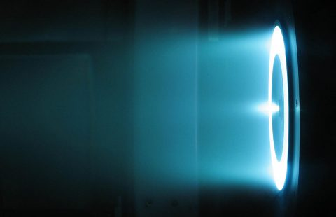 A solar electric propulsion Hall Effect thruster being tested under vacuum conditions at NASA. (NASA)