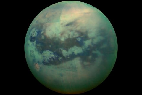 This composite image shows an infrared view of Saturn's moon Titan from NASA's Cassini spacecraft, captured in 2015. Several places on the image, visible through the moon's hazy atmosphere, show more detail because those areas were acquired near closest approach. (NASA/JPL/University of Arizona/University of Idaho)