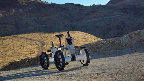 The DuAxel rover is seen here participating in field tests in the Mojave Desert. The four-wheeled rover is composed of two Axel robots. One part anchors itself in place while the other uses a tether to explore otherwise inaccessible terrain. (NASA/JPL-Caltech/J.D. Gammell)