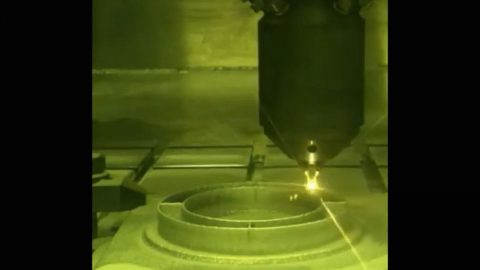 This photo shows a 3D printing technique where a printer head scans over each layer of a part, blowing metal powder which is melted by a laser. It's one of several ways parts are 3D printed at NASA's Jet Propulsion Laboratory, but was not used to create the parts aboard the Perseverance rover. (NASA/JPL-Caltech)