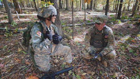 Zachary Labas, right, works with an Austin Peay State University ROTC cadet during a field training exercise prior to the COVID-19 Coronavirus pandemic at Fort Campbell, Kentucky. (APSU)