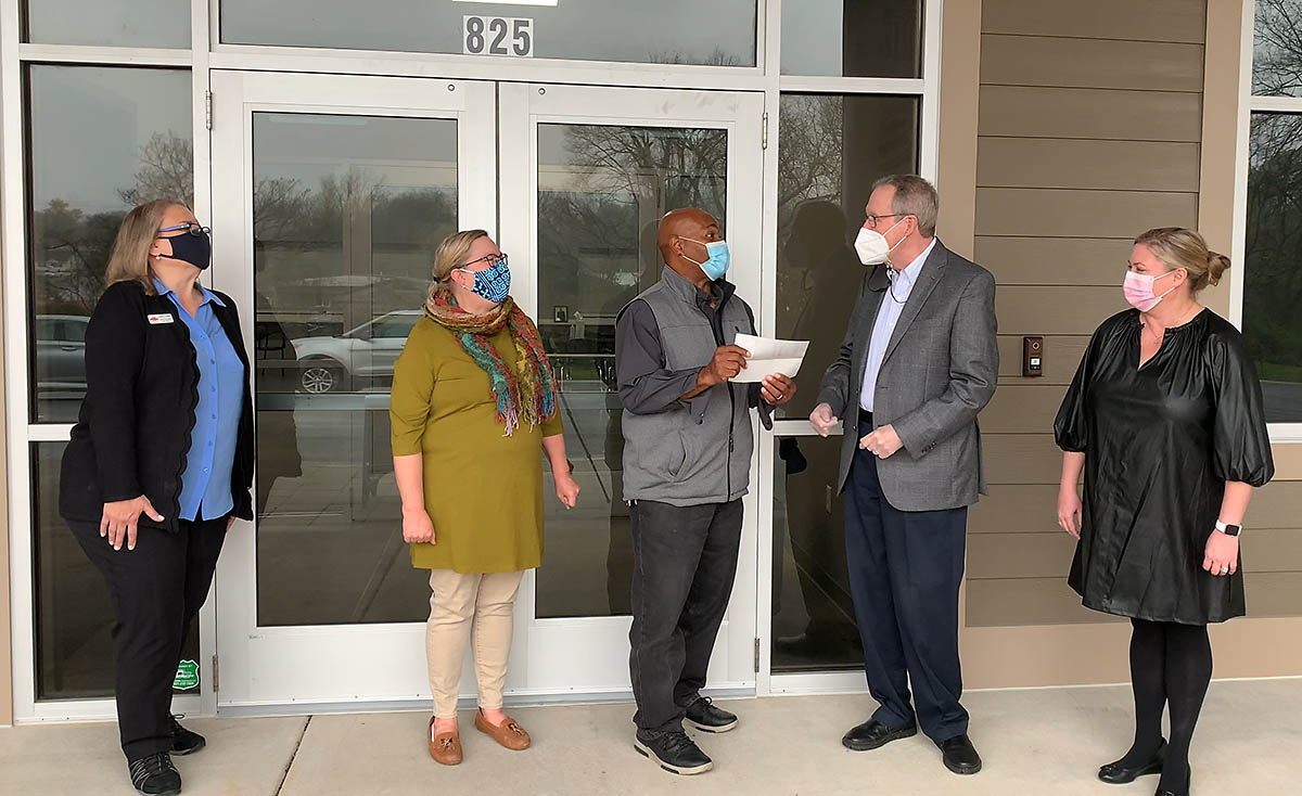 Ross Hicks (FPC Bicentennial Committee Chair), and Maggie McGrady-Sumonka (FPC Finance Committee Co-Chair) present a check for $150,000 to Issac Wright (Loaves & Fishes Construction Project Manager), Tamara Long (Loaves & Fishes President), and Karen Sorenson (Loaves & Fishes Board Member). (Morgan Adames, Mosaic Production and Entertainment)