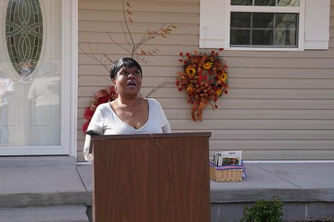 New homeowner Linda Ellison thanks friends and supporters during the dedication of her home, the 100th house built by Habitat for Humanity of Montgomery County. (Michael Rios)