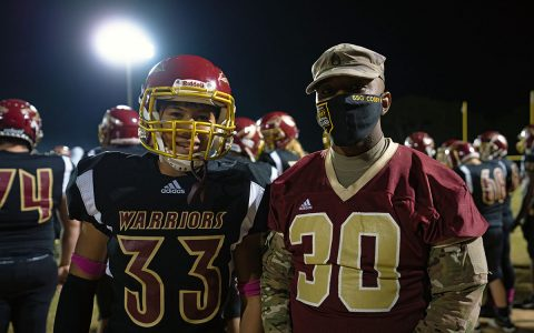Staff Sgt. Gregory Cosby, Recruiting and Retention Battalion, meets with student athletes at a Riverdale High School football game Oct. 16, in Murfreesboro. Recruiters from the Tennessee National Guard make efforts to be involved in the community to build relationships with potential recruits. (Staff Sgt. Timothy Cordeiro, Tennessee National Guard Public Affairs Office)
