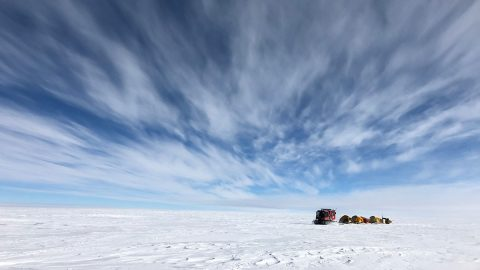 NASA scientists traverse Antarctica's icy landscape, towing scientific instruments and cold-weather gear with them. The team was tasked with collecting ground data to verify the accuracy of measurements made by the IceSat-2 satellite. (NASA)
