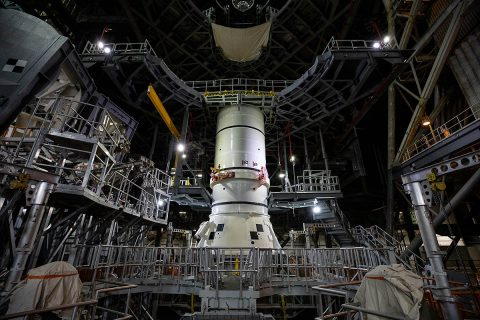 The aft segments of the Space Launch System solid rocket boosters for the Artemis I mission prepare to move from high bay 4 inside the Vehicle Assembly Building for stacking on the mobile launcher inside high bay 3 at Kennedy Space Center in Florida. (NASA/Cory Huston)