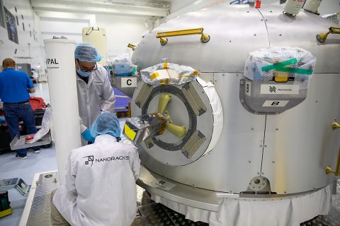 Technicians work on the Nanoracks Bishop Airlock inside the Space Station Processing Facility at NASA's Kennedy Space Center in Florida on Sept. 29, 2020, preparing the facility for its flight to the International Space Station. The first commercially funded airlock for the space station provides payload hosting, robotics testing, satellite deployment, and more. (NASA/KSC)