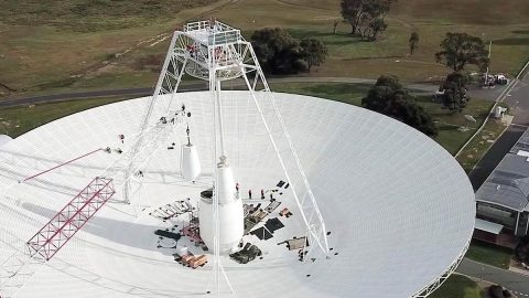 Crews conduct critical upgrades and repairs to the 70-meter-wide (230-foot-wide) radio antenna Deep Space Station 43 in Canberra, Australia. In this image, one of the antenna's white feed cones (which house portions of the antenna receivers) is being moved by a crane. (CSIRO)