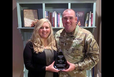 Tennessee National Guard Staff Sgt. Aaron McDermott poses with his wife Jill after being awarded the Strength Maintenance Area Group III (Southeast region) Recruiting and Retention NCO of the Year, November 20th. (1st Lt. Kealy Moriarty)